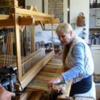 Woman on loom cottage industry photo