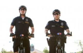 """I wonder how bike cops arrest people...  """"Alright, get in the basket..."""""""