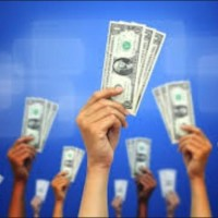 crowdfunding money in hands in the air photo