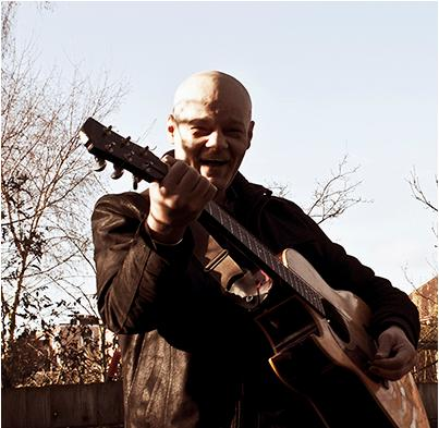 Lui Di Martino photo playing guitar