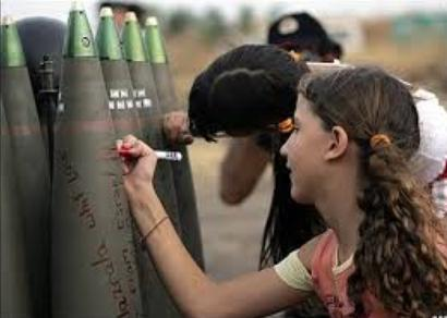 Israeli children write hate messages on bombs